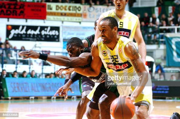 Devin Smith #32 of Fenerbahce Ulker competes with Romain Sato #10 of Montepaschi Siena during the Euroleague Basketball Last 16 Game 2 match between...