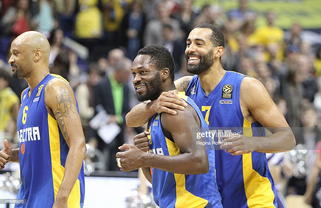 Devin Smith, #6, Jeremy Pargo, #4 and Brian Randle, #7 of Maccabi Electra Tel Aviv celebrating after the Turkish Airlines Euroleague Basketball Top 16 Date 14 game between Alba Berlin v Maccabi Electra Tel Aviv at O2 World on April 9, 2015 in Berlin, Germany.