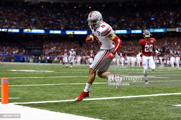 Devin Smith of the Ohio State Buckeyes catches a 47 yard touchdown pass in the third quarter against the Alabama Crimson Tide during the All State...