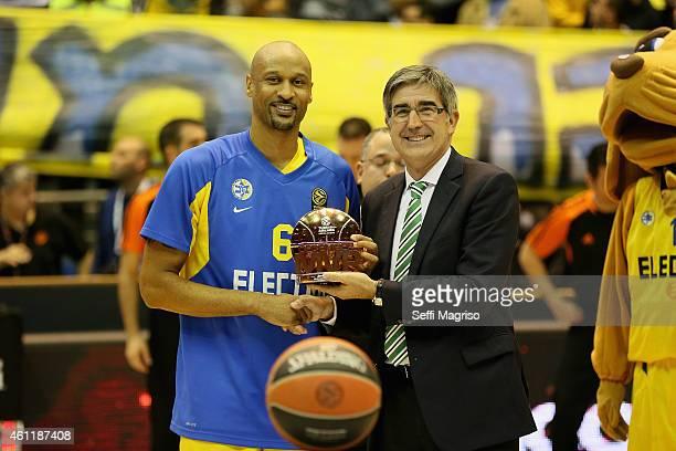 Devin Smith receiving the bwin December MVP before from Jordi Bertomeu CEO of Euroleague Basketball before the Euroleague Basketball Top 16 Date 2...