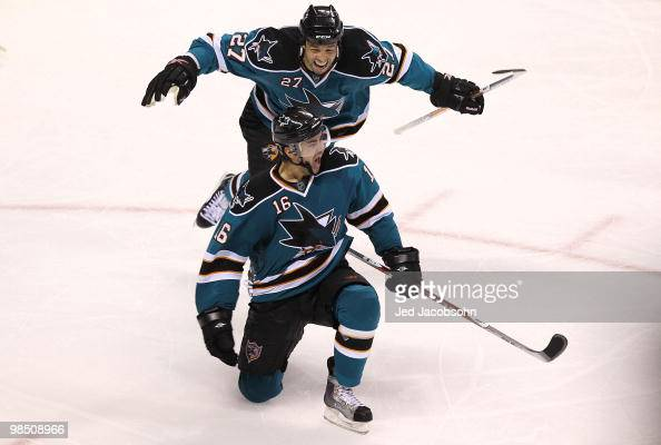 Devin Stoguchi of the San Jose Sharks celebrates with teammate Manny Malhotra after scoring the game winning goal in overtime against the Colorado...