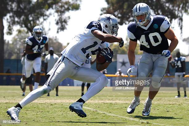 Devin Street on the Dallas Cowboys runs the ball while James Morris prepares to make the tackle on August 17 2016 in Oxnard California