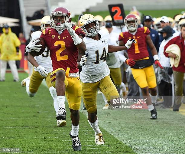 Devin Studstill of the Notre Dame Fighting Irish chases down Adoree' Jackson of the USC Trojans as he heads to the end zone for a touch down in the...