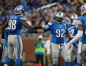 Devin Taylor and Haloti Ngata of the Detroit Lions celebrate a tackle agist the Minnesota Vikings in the second quarter at Ford Field on October 25...