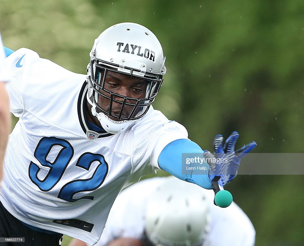 Devin Taylor #92 of the Detroit Lions goes through the afternoon drills during the first day of Rookie Camp on May 10, 2013 in Allen Park, Michigan.