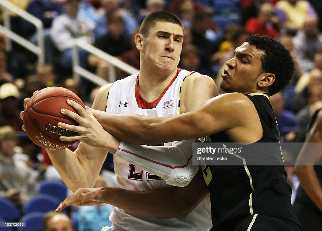 Devin Thomas #2 of the Wake Forest Demon Deacons defends against Alex Len #25 of the Maryland Terrapins in the second half of their game during the first round of the Men's ACC Basketball Tournament at Greensboro Coliseum on March 14, 2013 in Greensboro, North Carolina.