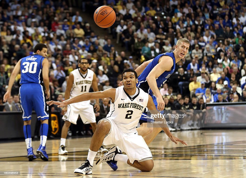 Devin Thomas #2 of the Wake Forest Demon Deacons looses the ball as Mason Plumlee #5 of the Duke Blue Devils looks on during their game at Lawrence Joel Coliseum on January 30, 2013 in Winston-Salem, North Carolina.