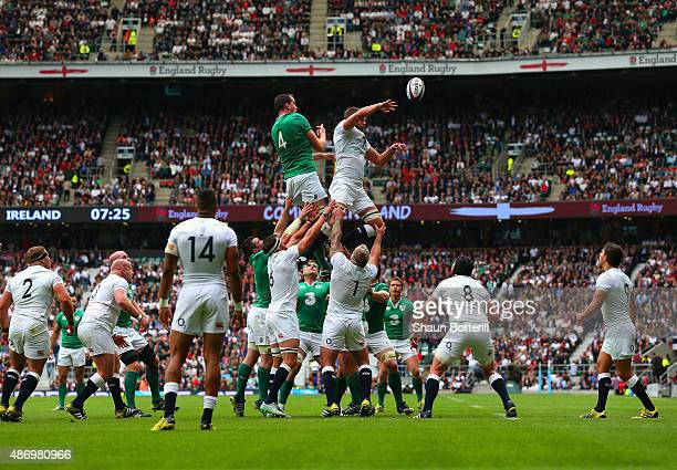 Devin Toner of Ireland and Geoff Parling of England go up for the line out ball during the QBE International match between England and Ireland at...