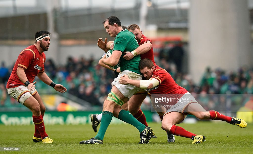 Devin Toner of Ireland is tackled by Samson Lee and Gethin Jenkins of Wales during the RBS Six Nations match between Ireland and Wales at the Aviva Stadium on February 7, 2016 in Dublin, Ireland.