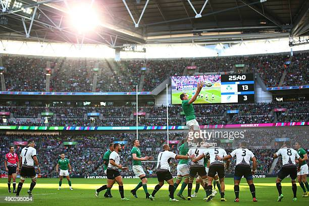 Devin Toner of Ireland jumps for a lineout ball during the 2015 Rugby World Cup Pool D match between Ireland and Romania at Wembley Stadium on...