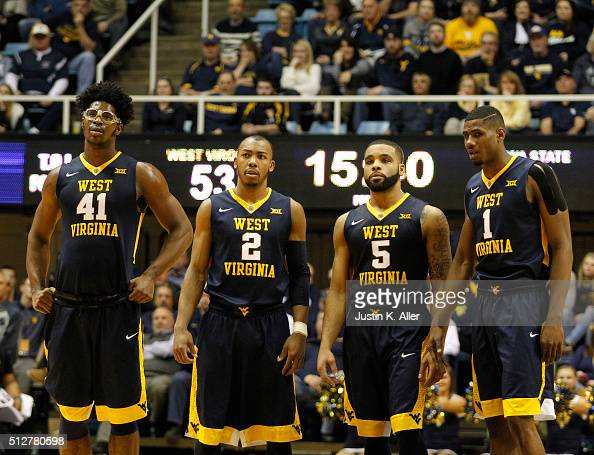 Devin Williams Jevon Carter Jaysean Paige and Jonathan Holton of the West Virginia Mountaineers in action during the game against the Iowa State...