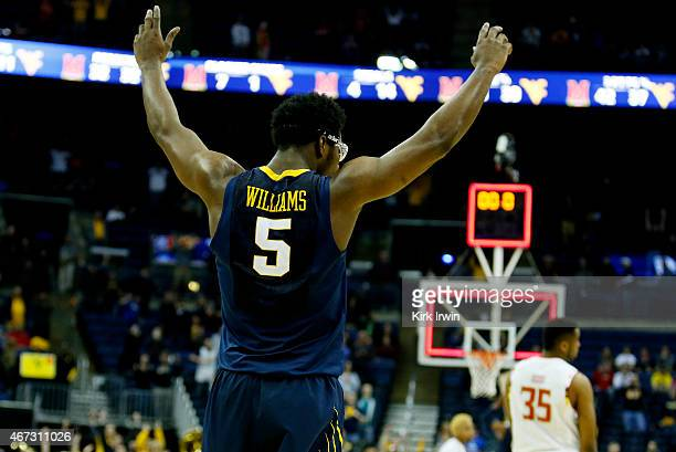 Devin Williams of the West Virginia Mountaineers celebrates after they defeated the Maryland Terrapins 69 to 59 during the third round of the 2015...