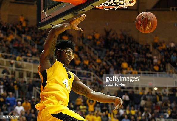 Devin Williams of the West Virginia Mountaineers dunks the ball during the game against the Kansas Jayhawks at the WVU Coliseum on January 12 2016 in...