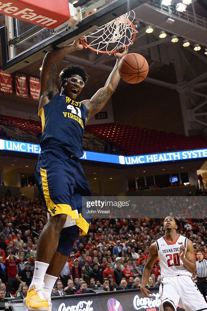 Devin Williams of the West Virginia Mountaineers dunks the basketball during the first half against the Texas Tech Red Raiders on January 23 2016 at...
