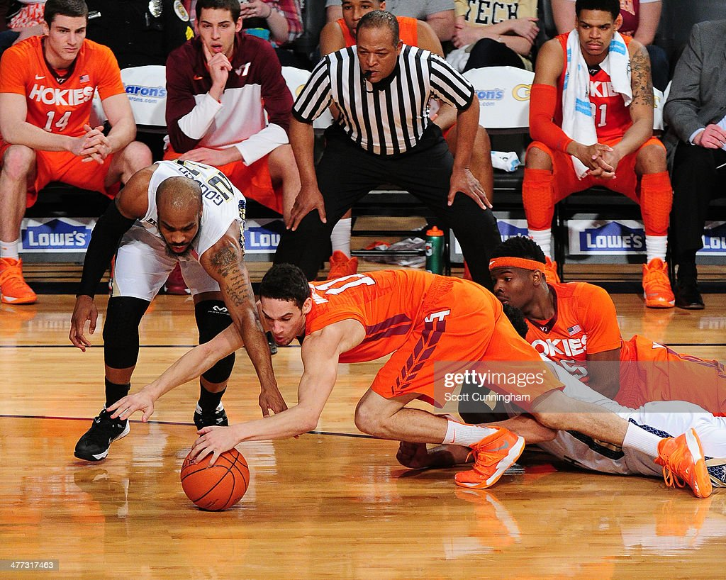 Devin Wilson #11 of the Virginia Tech Hokies battles for a loose ball against <a gi-track='captionPersonalityLinkClicked' href=/galleries/search?phrase=Trae+Golden&family=editorial&specificpeople=7360099 ng-click='$event.stopPropagation()'>Trae Golden</a> #23 of the Georgia Tech Yellow Jackets at McCamish Pavilion on March 8, 2014 in Atlanta, Georgia. Photo by Scott Cunningham/Getty Images)