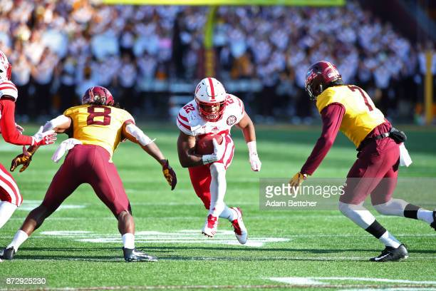 Devine Ozigbo of the Nebraska Cornhuskers carries the ball in the fourth quarter against the Minnesota Golden Gophers at TCF Bank Stadium on November...