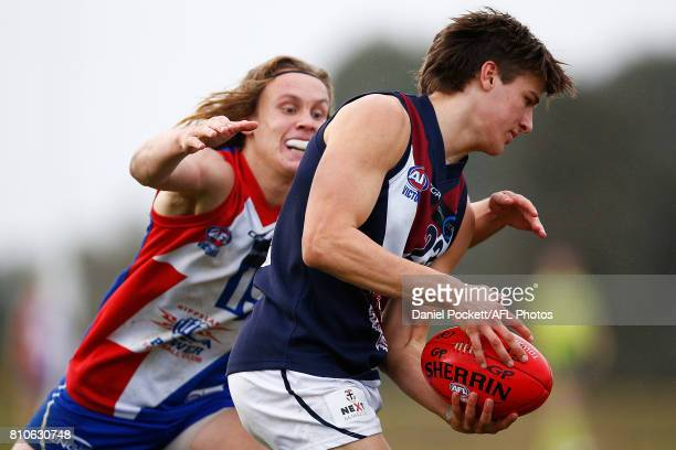 Devlin Brereton of the Dragons is tackled by Callum Porter of the Power during the round 12 TAC Cup match between Gippsland and Sandringham at Casey...