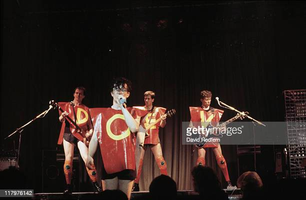 bassist Gerald Casale singer Mark Mothersbaugh guitarist Bob Mothersbaugh and guitarist Bob Casale US New Wave band dressed in red plastic ponchos...