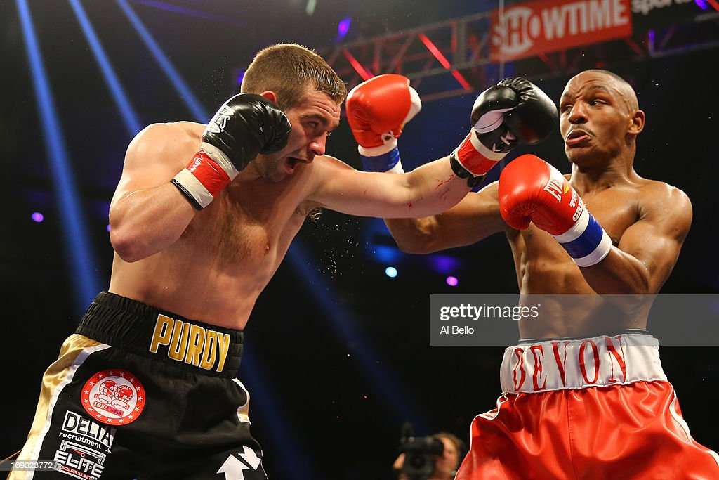 Devon Alexander and Lee Purdy exchange punches during their IBF Welterweight Title fight at Boardwalk Hall Arena on May 18, 2013 in Atlantic City, New Jersey.