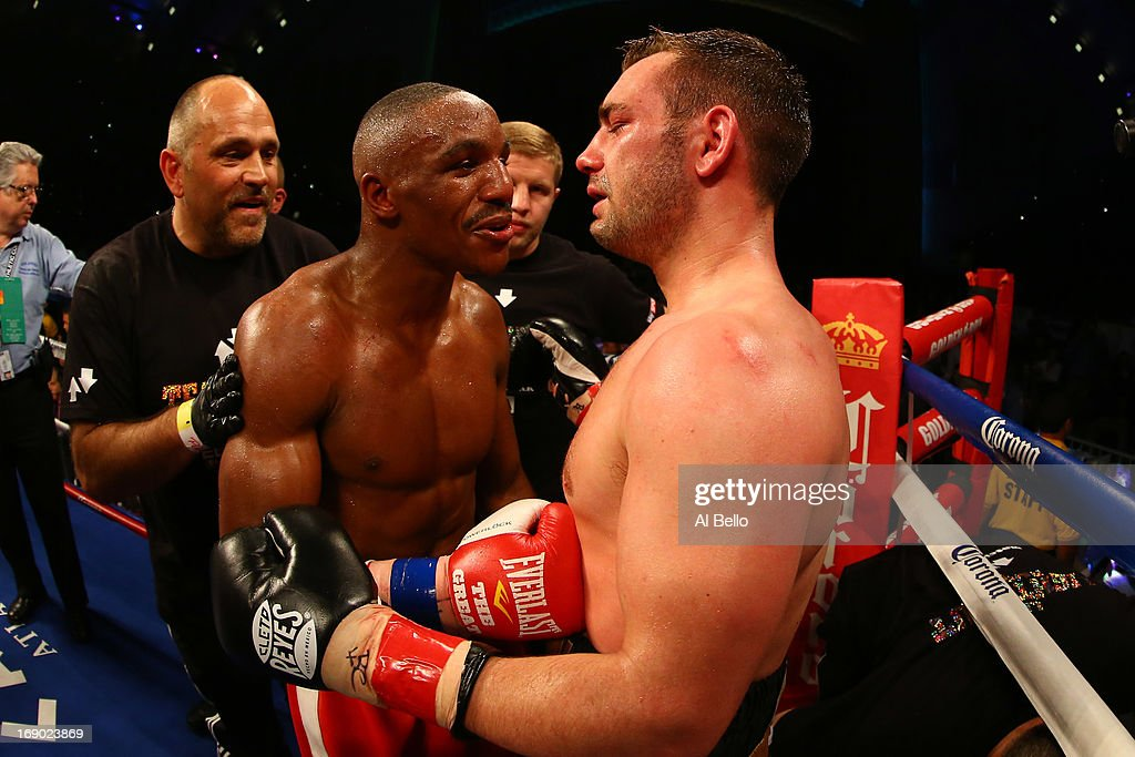 Devon Alexander and Lee Purdy meet after Purdy's corner stopped the fight in the seventh round during their IBF Welterweight Title fight at Boardwalk Hall Arena on May 18, 2013 in Atlantic City, New Jersey.