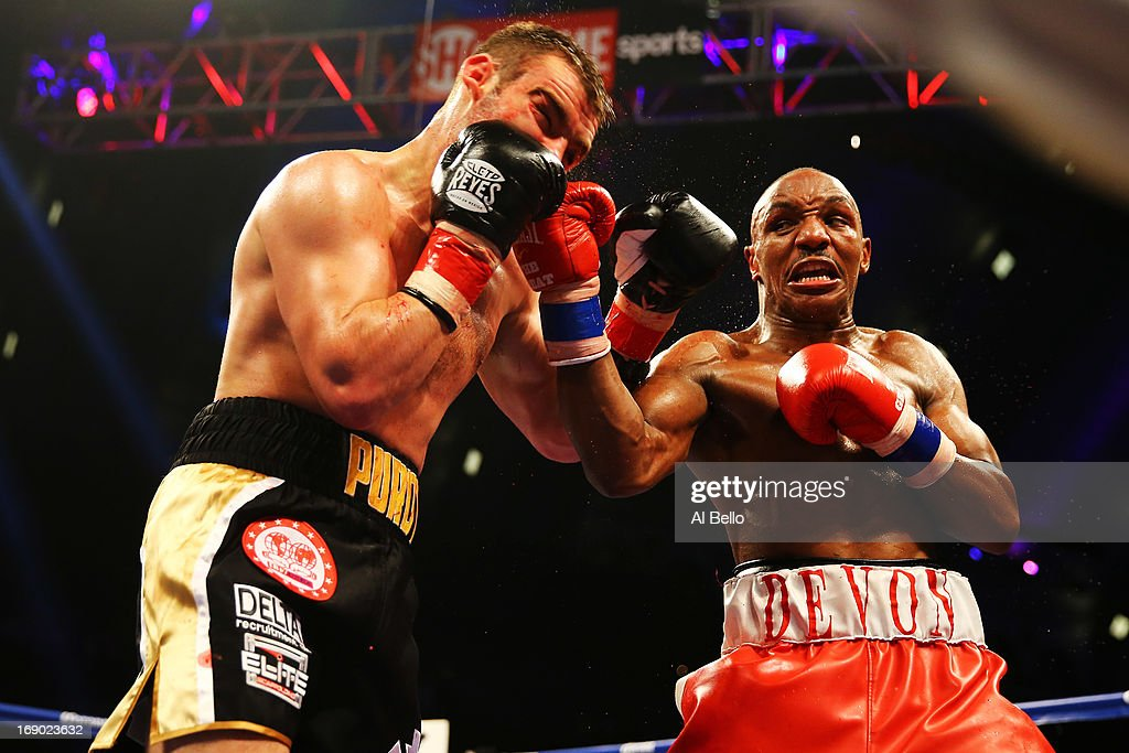 Devon Alexander punches Lee Purdy during their IBF Welterweight Title fight at Boardwalk Hall Arena on May 18, 2013 in Atlantic City, New Jersey.