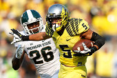 Devon Allen of the Oregon Ducks heads toward the end zone on a 70yard touchdown reception in the first half of the game against the Michigan State...