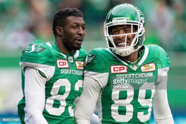 Devon Bailey and Duron Carter of the Saskatchewan Roughriders celebrate after a touchdown in the game between the Calgary Stampeders and Saskatchewan...