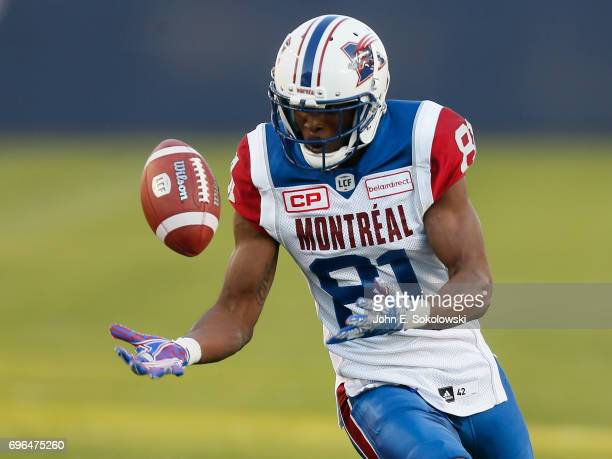 Devon Bailey of the Montreal Alouettes tries to control a pass during a CFL preseason game against the Toronto Argonauts at BMO field on June 8 2017...