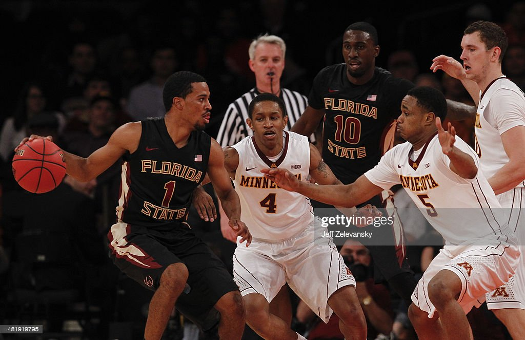 Devon Bookert #1 of the Florida State Seminoles looks to pass against the Minnesota Golden Gophers during the NIT Championship semifinals at Madison Square Garden on April 1, 2014 in New York City.