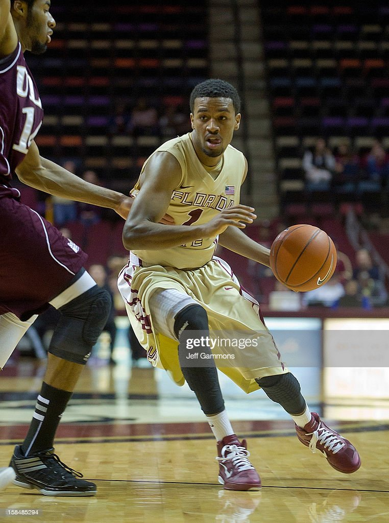 Devon Bookert #1 of the Florida State Seminoles makes his way past Ife Eke during the game at the Donald L. Tucker Center on December 17, 2012 in Tallahassee, Florida. Florida State won 63-48.