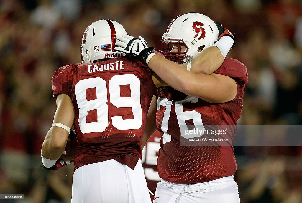 Devon Cajuste and Kevin Danser #76 of the Stanford Cardinal celebrates after Cajuste caught a forty yard touchdown pass against the San Jose State Spartans during the first quarter at Stanford Stadium on September 7, 2013 in Palo Alto, California.