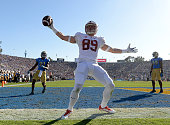Devon Cajuste of the Stanford Cardinal celebrates his touchdown for a 2110 lead in front of Tahaan Goodman and Myles Jack of the UCLA Bruins during...