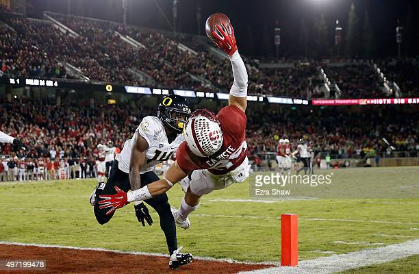 Devon Cajuste of the Stanford Cardinal makes a onehanded catch as Ugo Amadi of the Oregon Ducks pushes him outofbounds at Stanford Stadium on...