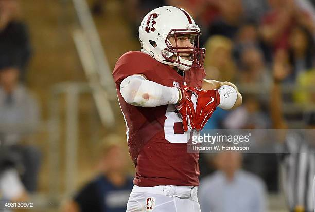 Devon Cajuste of the Stanford Cardinal's celebrates after scoring a touchdown against the UCLA Bruins during the second quarter of an NCAA football...