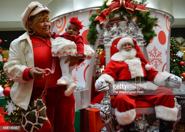 HYATTSVILLE MD DECEMBER Devon Duggins of Greenbelt Md walks away with her daughter Kendall Bernice Elisa 3 mos after a holiday picture with 'Santa...