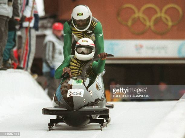 Devon Harris and Michael Morgan of Jamaica start their run on the first day of the twoman bobsleigh event at the Spiral near Nagano 14 February The...