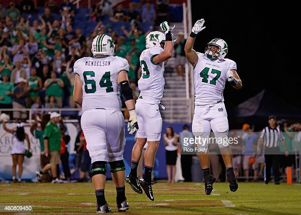 Devon Johnson of the Marshall Thundering Herd celebrates with Eric Frohnapfel after scoring a touchdown during the second quarter of the game against...