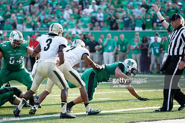 Devon Johnson of the Marshall Thundering Herd dives into the end zone for the go ahead touchdown in the second half against the Purdue Boilermakers...