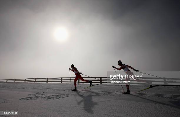 Devon Kershaw and Alex Harvey of Canada compete in the men's 15km Cross Country Skiing during day two of the Winter Games NZ at the Snow Farm on...