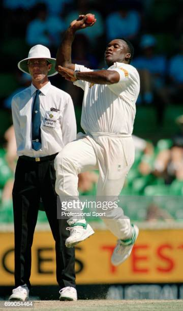 Devon Malcolm bowling for England during the 5th Test match between Australia and England at the WACA Perth Australia 3rd February 1995 The umpire is...