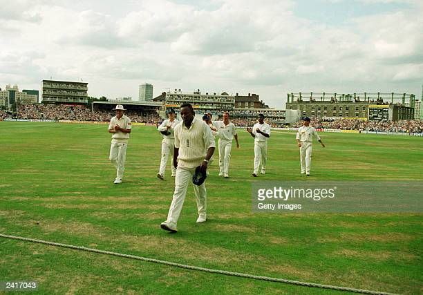 Devon Malcolm of England leaves the field after taking 9 for 57 in the second innings of the Third test between England and South Africa on August 22...