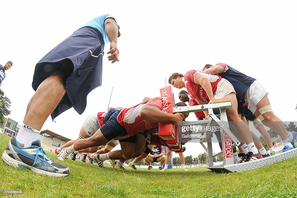D' OLONNE, FRANCE - JUNE 11: (SOUTH AFRICA OUT) Devon Marthinus. Michael Willemse and Andrew Beerwinkel scrum the machine as Marne Coetze watches during the South African U/20 training session at Stade les Sables d' Olonne on June 11, 2013 in les Sables d' Olonne, France.