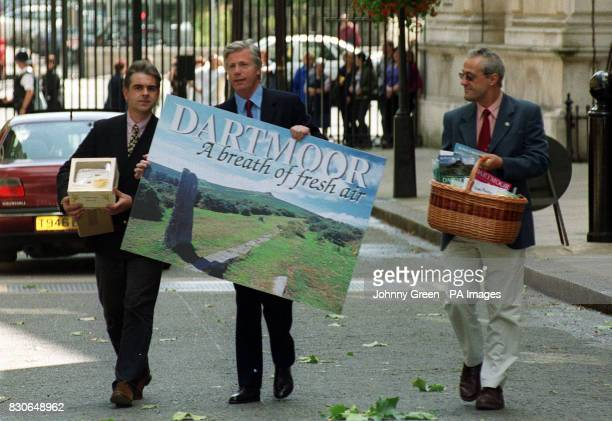 Devon MP John Burnett carries a postcard to Prime Minister Tony Blair in Downing Street accompanied by Adam Southwell acting chairman of the Dartmoor...