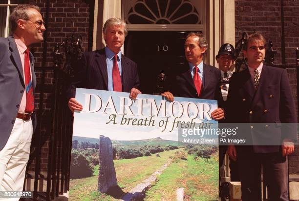 Devon MP John Burnett gives a postcard for Prime Minister Tony Blair to Tourism Minister Dr Kim Howells in Downing Street accompanied by Adam...
