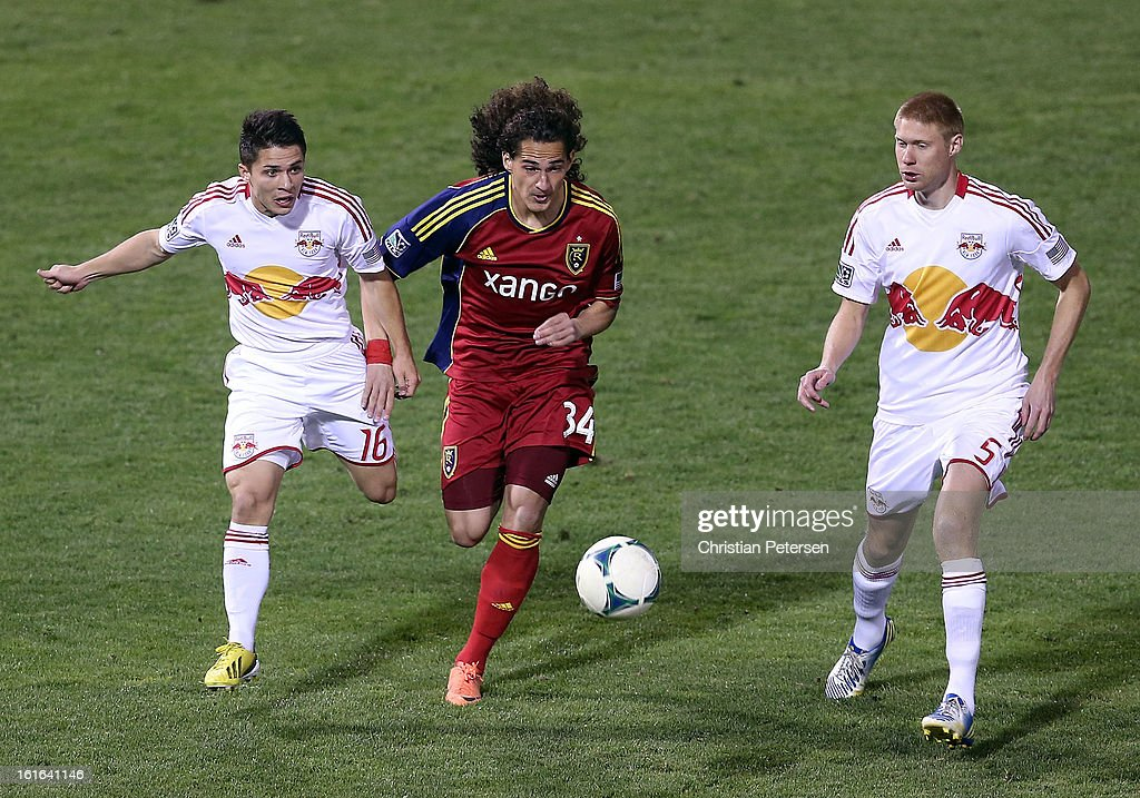 Devon Sandoval #34 of Real Salt Lake attempts to control the ball pressured by Connor Lade #16 and Markus Holgersson #5 of the New York Red Bulls during FC Tucson Desert Diamond Cup at Kino Sports Complex on February 13, 2013 in Tucson, Arizona.