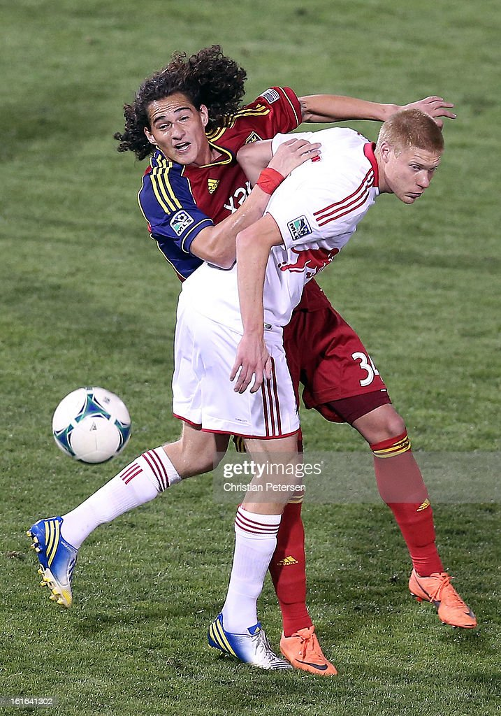 Devon Sandoval #34 of Real Salt Lake attempts to control the ball pressured by Markus Holgersson #5 of the New York Red Bulls during the first half of the FC Tucson Desert Diamond Cup at Kino Sports Complex on February 13, 2013 in Tucson, Arizona.