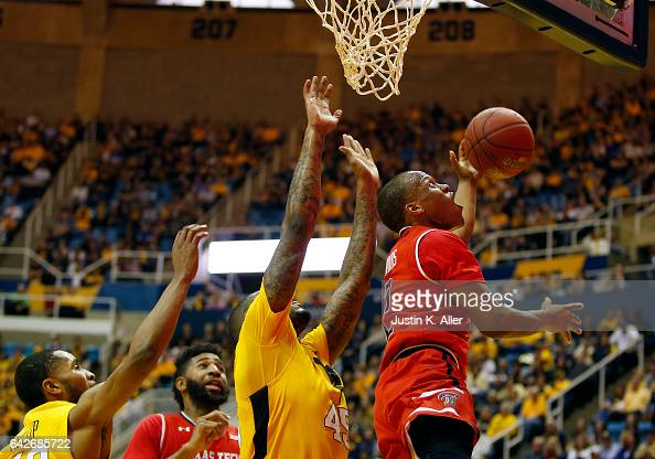 Devon Thomas of the Texas Tech Red Raiders attempts a lay up against Elijah Macon of the West Virginia Mountaineers at the WVU Coliseum on February...