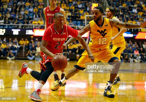 Devon Thomas of the Texas Tech Red Raiders drives the ball against Tarik Phillip of the West Virginia Mountaineers at the WVU Coliseum on February 18...