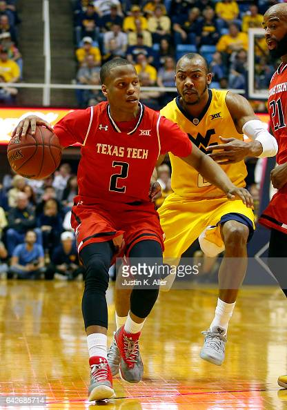 Devon Thomas of the Texas Tech Red Raiders handles the ball against Jevon Carter of the West Virginia Mountaineers at the WVU Coliseum on February 18...
