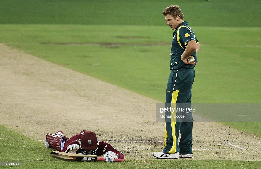 Devon Thomas of the West Indies lies on the ground after he was run out by James Faulkner of Australia during game five of the Commonwealth Bank International Series between Australia and the West Indies at Melbourne Cricket Ground on February 10, 2013 in Melbourne, Australia.